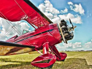 TIna Weida: Lady Red- a stylized photograph of a red vintage airplane