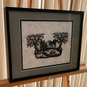 Karen Bell: paper cutting of a horse-drawn sleigh in a forest with deer