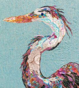 quilted fabric collage of a blue heron by Laura Pucci
