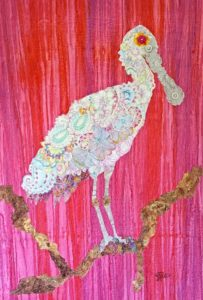 quilted fabric collage of a Roseate Spoonbill on a fuchsia background