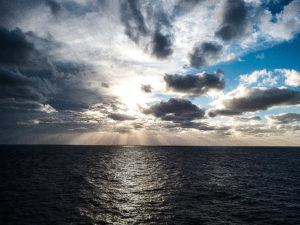 photograph of dramatic cloud formation over the ocean