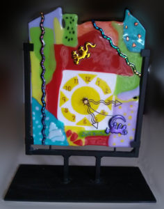 clock made of fused glass and iron by Suzanne Pisano